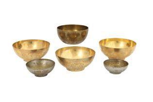 FIVE ENGRAVED BRASS MAGIC BOWLS AND A QAJAR BOWL WITH FIGURAL DECORATION Iran, 19th and 20th century