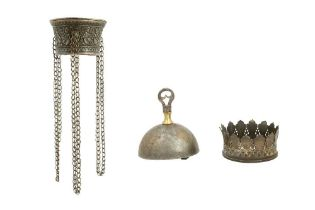 A QAJAR GOLD-DAMASCENED STEEL BELL AND TWO QALYAN (WATER PIPE) CUP METAL FITTINGS Iran, 19th century