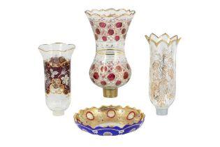 THREE WHEEL-CUT, DIAMOND-CUT AND GILT GLASS LAMP COVERS AND A DISH Possibly Bohemia, Czech Republic,