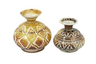 TWO SAFAVID COPPER LUSTRE-PAINTED POTTERY BOTTLES Iran, 17th century