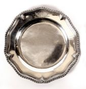 A George III silver plate, Charles Wright, London 1774, of circular shape with gadrooned rim,