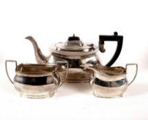 A three-piece silver tea set, Birmingham 1934, comprising teapot, sugar basin and milk jug,