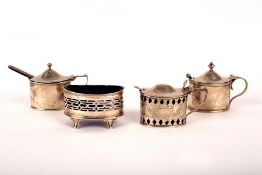 Three silver mustard pots, circa 1900, with blue glass liners and a similar open salt,