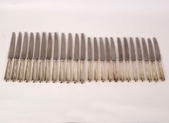 A set of twelve silver handled dessert knives and twelve matching table knives,