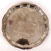 A silver salver, Chester 1912, with pie crust rim and presentation inscription, 33cm diameter,