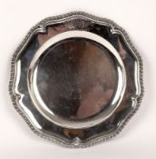 A George II silver plate, George Wickes, London 1758, of wavy outline with gadrooned rim,