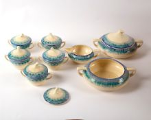 A Clarice Cliff part dinner service in the Bizarre Aura pattern, Wilkinson and Son,