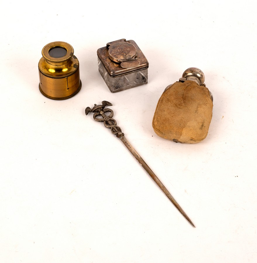 A Victorian silver letter knife, London 1849, with caduceus handle, a small silver hip flask,