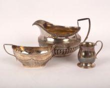 A George III silver cream jug, Guest & Craddock, London 1808, part gadrooned, 15cm high,