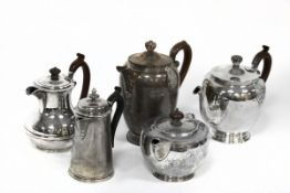 A silver coffee pot and teapot, Birmingham 1928, two coffee pots and a teapot (lacking handle),