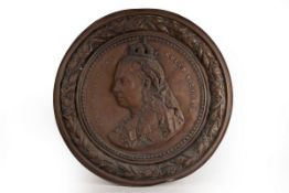 A large brass charger embossed 'Her Majesty the Queen Victoria', 62.