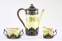 A Royal Worcester silver mounted coffee pot, sugar basin and cream jug, the mounts Adie Bros.
