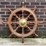 A brass mounted eight-point ships wheel, 91.