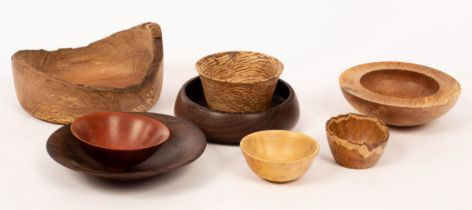 Chris Robertson, four turned wood bowls, various sizes and woods, the largest with natural form rim,