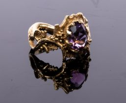 A 1960s 9ct gold and amethyst ring, of modernist design with scrolling vines,