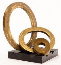 H Simon, a modernist sculpture of three bronzed interchangeable rings on a black ridged base,
