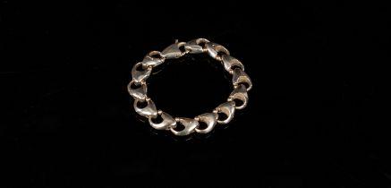 Brett Payne, a silver bracelet, Sheffield 2001, of heart shaped padlock links, 20.