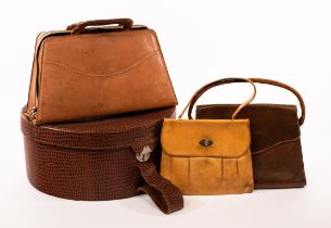 Theo Merrett, a group of hand tooled leather bags, including hat box,