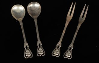 Georg Jensen: A pair of silver spoons and a pair of pickle forks,