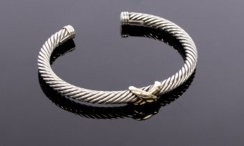 David Yurman, a silver and gold cable bangle, with central 14ct yellow gold cross, signed,