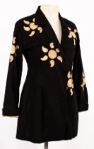 Issey Miyake, a black cotton 'sunshine' jacket with decorative cut-out designs,