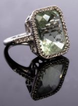 Kiki McDonough, a green amethyst and diamond cluster ring,