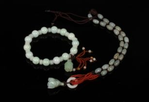 A jade bead bracelet, a similar necklace and three costume necklaces, etc.