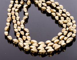 Loulou de la Falaise for Yves Saint Laurent, a gold toned beaded multi-strand necklace,