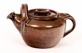 Bryan Erasmus, a temoku glaze teapot, incised mark Raz to base,