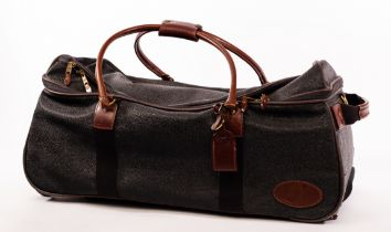 Mulberry, a black Scotchgrain travel bag with leather handles, pockets to exterior, luggage tag,