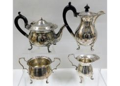 A 1919 four piece London silver tea set by Charles