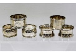 Two pairs of silver napkin rings & two inscribed s
