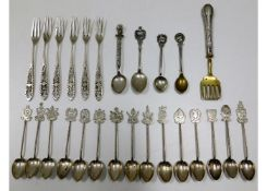 A quantity of silver & white metal spoons & other