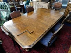 A large Victorian oak extending dining table with