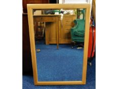 An Ercol wall mirror with bevelled glass, 37in x 2