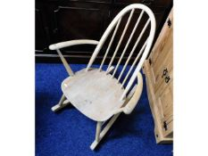 An Ercol elm seated childs rocking chair, later st