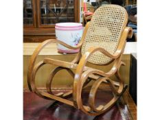 A chairs bentwood style cane rocking chair