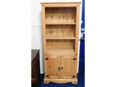 A modern pine bookcase with cupboard under, 72in t