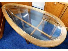 A 1970's teardrop shape retro teak glass topped co