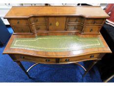 A mahogany Regency style ladies desk by Bowlings,