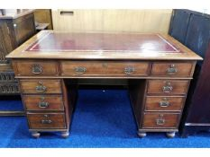 A Victorian mahogany pedestal writing desk with brass fittings (one pin & handle missing from one of