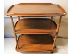 An Ercol three tier trolley, 28.25in wide x 18.25i