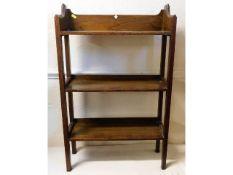 An open oak bookcase, 34.75in high x 21.75in wide x 7.75in deep