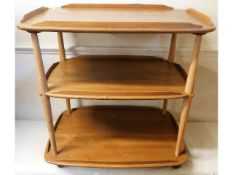 An Ercol three tier trolley, damage to one of top