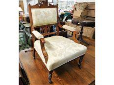An Edwardian walnut armchair
