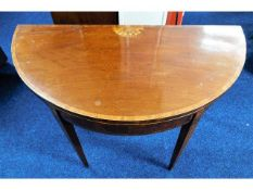 A Regency period D shaped card table on tapered le