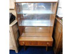 A teak retro mirrored back display cabinet & drawe