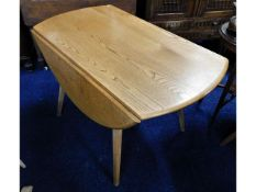 An Ercol elm drop leaf dining table, 49.75in exten