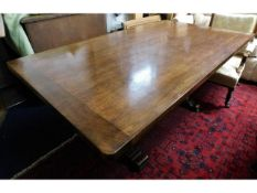 A oak pedestal table with cleated ends, 68.5in lon