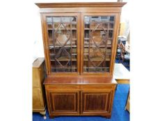 A good antique mahogany bookcase with bevelled gla